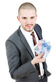 Happy young business man with money — Stock Photo