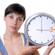 Caucasian young woman holding a big clock — Stock Photo
