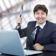 Crazy business man with a hammer — Stock Photo