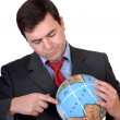 Business mholding globe — Stock Photo #23827357