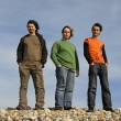 Three casual young men at the beach — Stock Photo