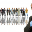 Business man in front of a group of — Stock Photo #23828755