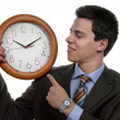 Handsome business mholding clock — Stock Photo #23829311