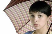 Joven morena con paraguas — Foto de Stock