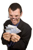 Young business man with money — Stock Photo