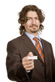 Young businessman with card — Stock Photo
