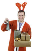 Young man santa holding some gifts — Stock Photo