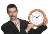 Silly business man portrait with a clock — Stock Photo