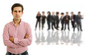 Young man in front of a group of — Stock Photo