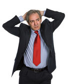 Businessman in a suit gestures with a headache — Stock Photo