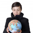 Royalty-Free Stock Photo: Pretty young woman holding the globe
