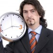Business man with clock on white background — Stock Photo