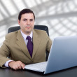 Young business man working with laptop — Stock Photo