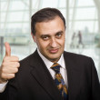 Stock Photo: Business mgoing thumbs up