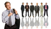 Mature business man in front of a group of — Stock Photo