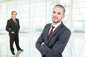 Young businessmen portrait at the office — Stock Photo