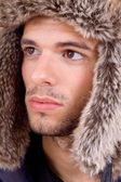 Studio picture of a young man dressed for winter — Stock Photo