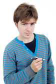 Young casual man with a pen — Stock Photo
