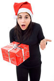 Beautiful young girl holding a christmas gift — Stock Photo