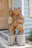 The wooden sculpture of bear with sandals made of bark, Perm edg — Stock Photo