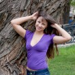 Beautiful woman on nature in a park -  