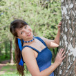 Beautiful woman on nature near a birch — Stock Photo #13901784