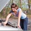 Woman a driver repairs a car — Stock Photo