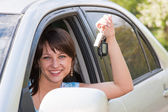 Woman driver after the helm of car with the keys in hands — Stock Photo