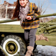 Woman in a museum of military equipment — ストック写真