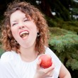 Beautiful woman with apple in hand - Stock Photo