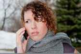 Young woman emotionally talking on a cell phone — Stock Photo
