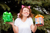 Young woman with a gift in their hands — Stock Photo