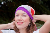 Young woman with a kerchief on her head — Stock Photo