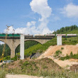 Stock Photo: New railway bridge on a background blue sky
