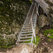 A metallic stair is in a rock - Stock Photo