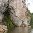 Stock Photo: Stone with cave on river, Sverdlovsk area