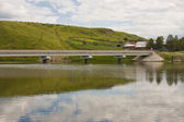 Motor-car bridge across the river — Stock Photo
