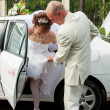 Stock Photo: Happy groom and fiancee go out car