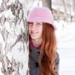 Woman near a birch in winter in a park — Stock Photo #14174569