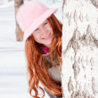 Woman near a birch in winter in a park — Stock Photo #14174839