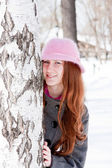 Woman near a birch in winter in a park — Stock Photo