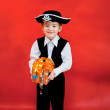 Little boy in the suit of pirate with a gift in hands — Stock Photo #15721689
