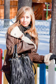 Beautiful woman in a winter park — Stock Photo