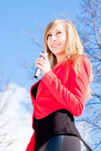 Beautiful woman with a microphone in hands — ストック写真