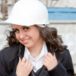 A young  business woman is in a helmet — Stock Photo