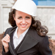 A young business woman is in a helmet — Stock Photo #17375773