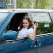 Young happy woman after the helm of car with the keys in hands — Stock Photo