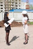 Two young business women on a background the built building — Stock Photo