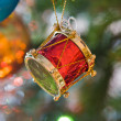 New-year toy a drum hangs on a christmas tree — Stock Photo