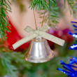 New-year toy a bluebell hangs on a christmas tree — Foto de Stock